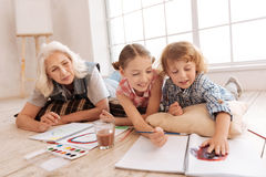 Positive creative children having an art lesson Royalty Free Stock Photography