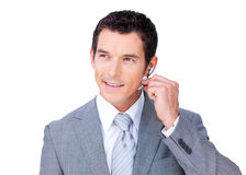 Positive customer service agent using headset. Against a white background Stock Image