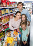 Positive customers with children buying food in hypermarket Stock Image