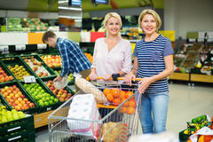 Positive customers choosing fresh frusits Royalty Free Stock Image