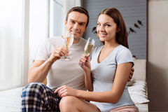 Positive cute couple looking at you Stock Image