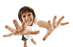 Positive cute kid trying Stock Photography