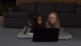 Multiracial kids watching cartoons on laptop stock video