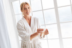Positive delighted blonde woman being ready for procedure Royalty Free Stock Images