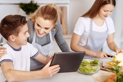Positive delighted family having fun in the kitchen Stock Image