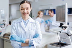 Positive delighted female lab assistant smiling on camera Stock Photography