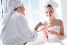 Positive delighted girl being ready for procedure Stock Images