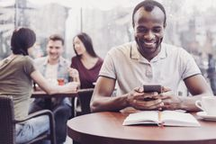 Positive delighted international freelancer being in cafe royalty free stock photo