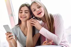 Positive delighted little females dreaming about holidays stock photos