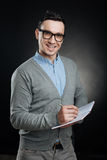 Positive delighted man holding notebook in left hand Royalty Free Stock Photos