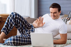 Positive delighted man making a video call Stock Photo