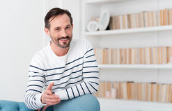 Positive delighted man stretching his hand out Stock Images