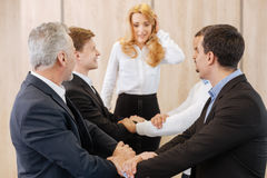 Positive delighted men standing in pairs Royalty Free Stock Image