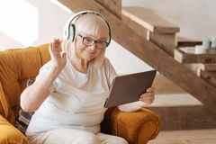 Positive delighted woman listening to music Stock Photography
