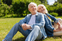 Positive delighted woman looking at her mature husband Stock Images