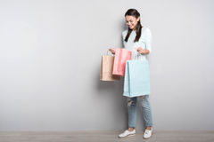 Positive delighted woman resting after shopping Royalty Free Stock Photo