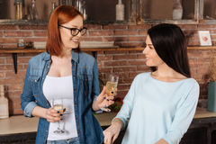 Positive delighted women drinking champagne Stock Images