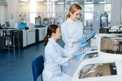 Positive delighted women working in the laboratory Royalty Free Stock Photography