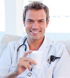Positive doctor having a break Stock Images