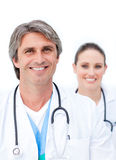 Positive doctors looking at the camera Royalty Free Stock Photo
