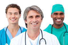 Positive doctors smiling at the camera Stock Photos