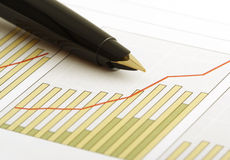 Positive earning chart. A pen on a positive earning chart.(shallow focus on the tip of the pen Stock Photography