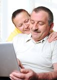 Positive elderly couple w Royalty Free Stock Image