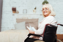 Positive elderly disabled woman resting at home Royalty Free Stock Photography