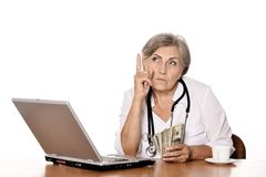 Positive elderly doctor Stock Images