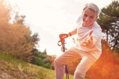 Positive elderly man suggesting a hand of support royalty free stock photography