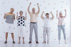 Positive elderly people in retirement. Positive elderly people have fun together. Happy life in retirement concept stock photography