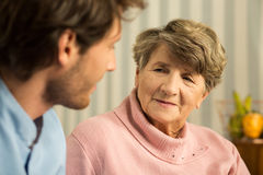 Positive elderly woman with carer Royalty Free Stock Images
