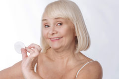 Positive elderly woman caring about her appearance Royalty Free Stock Photo