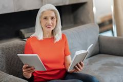 Positive elderly woman looking at you stock photography