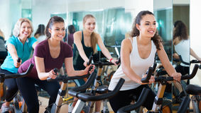 Positive elderly and young women working out hard Stock Image