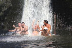 Positive emotions while bathing in a waterfall Royalty Free Stock Photography