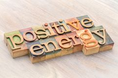 Positive energy word abstract in wood type stock image