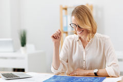 Positive engineer enjoying the engineering project in the office Stock Images