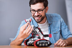 Positive engineer using robot Royalty Free Stock Image