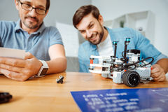 Positive engineers testing the robot stock images