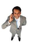 Positive ethnic businessman on phone Stock Photos