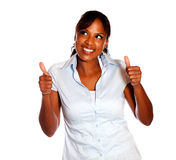 Positive ethnic woman lifting the fingers up Royalty Free Stock Photography