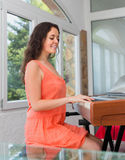 Positive european girl having piano class Royalty Free Stock Photo