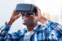Positive excited man holding 3g glasses Royalty Free Stock Photo