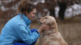 Positive woman bonding with her dog outdoors stock video