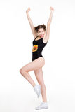 Positive excited young woman print dancing and jumping like cheerleader Royalty Free Stock Photos