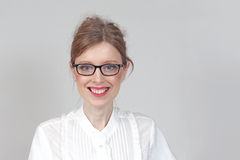 Positive face expression. Young woman with eyeglasses and positive face expression stock photo