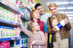 Positive family of four buying pasteurized milk Royalty Free Stock Photography