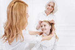 Positive family members wearing accessories Stock Image