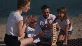Positive family play jenga game stock video